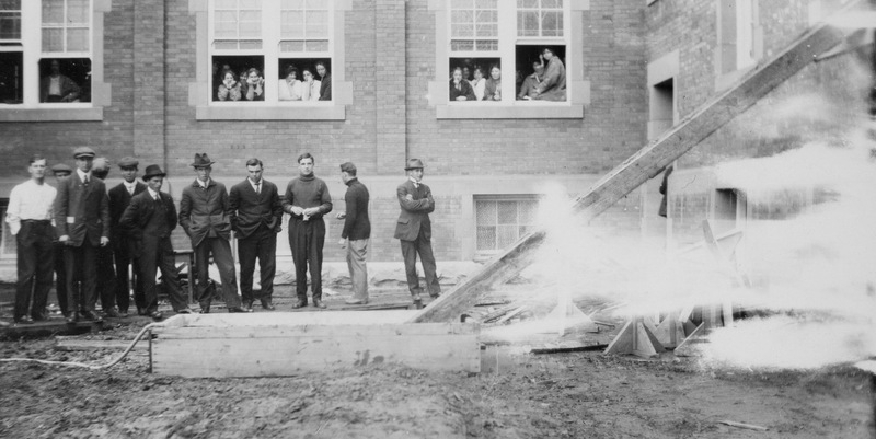 Dunking Shute. Initiation chute - soak with soft soap and shot them down from Room 121, back of Athabasca Hall. October 1, 1913.