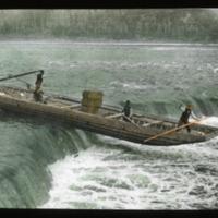 Boat Navigating Waterfall