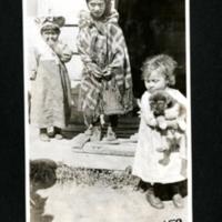 Three Children and a Puppy